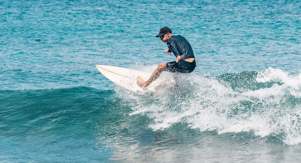 Surfing at Naladhu Maldives Private Resort